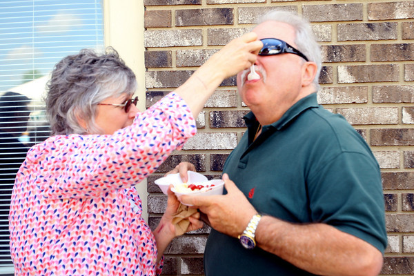 6-5-14   --- Joyce Hollingsworth feeds Mike Whiteman a bite of the strawberry shortcake they were sharing at the Strawberry Festival downtown. --<br />   Tim Bath | Kokomo Tribune