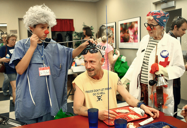 6-18-14<br /> Kokomo Rescue Mission birthday<br /> Dr. Bigfoot and Nurse Humdinger clown around with Jesse Mitchell (center) during the Kokomo Rescue Mission birthday celebration.<br /> Kelly Lafferty | Kokomo Tribune