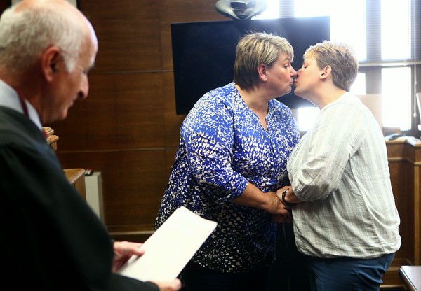 6-26-14<br /> Same-sex weddings<br /> Samantha Hall-Fisher and Heather Hall-Fisher share a kiss in the Howard County Courthouse on Wednesday after Judge Hopkins performed their marriage ceremony. <br /> Kelly Lafferty | Kokomo Tribune