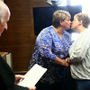 6-26-14<br /> Same-sex weddings<br /> Samantha Hall-Fisher and Heather Hall-Fisher share a kiss in the Howard County Courthouse on Wednesday after Judge Hopkins performed their marriage ceremony. <br /> Kelly Lafferty   Kokomo Tribune