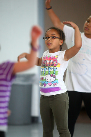 6-12-14<br /> Carver Community Center Hip Hop Class<br /> Kiallah Green, 7, rehearses the dance routine the Hip Hop Class at Carver Community Center has been working on for weeks.<br /> Kelly Lafferty | Kokomo Tribune