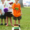6-25-14<br /> Craft Fest<br /> Lukas Spoonemore, 5, attempts to toss the bean bag into one of the cans at a game station at the Craft Fest on Wednesday.<br /> Kelly Lafferty | Kokomo Tribune