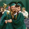6-8-14<br /> Eastern Graduation<br /> Hannah Broo and Heather Wright hug as the procession for Eastern's graduation begins on Sunday.<br /> Kelly Lafferty | Kokomo Tribune