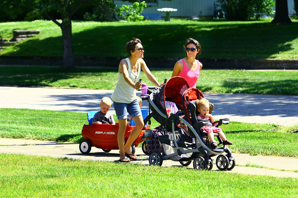 6-3-14   --- Lifelong residents and Twins, Christy and Misty Howell who are both married to brothers who are also from Greentown, stroll through Greentown with their kids. --<br />   Tim Bath | Kokomo Tribune