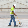 6-20-14<br /> Grissom Runway<br /> Mike Lechner uses the measuring wheel on Grissom's taxiway A, as a construction crew works on repairs.<br /> Kelly Lafferty | Kokomo Tribune