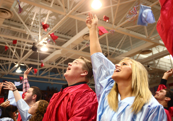 6-7-14<br /> Maconaquah Graduation<br /> Ross Myers and Kirstyn Sommers throw their caps in the air at the end of Maconaquah's graduation ceremony.<br /> Kelly Lafferty | Kokomo Tribune