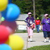 6-13-14<br /> Relay for Life<br /> Pat Browning and Butch Barnard walk the track at Maple Crest Middle School as they look at the luminaria alongside it during Relay for Life on Friday.<br /> Kelly Lafferty | Kokomo Tribune