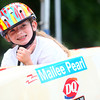 6-21-14<br /> Soap box Derby<br /> Mailee Pearl Sewell, 7, gives the thumbs up as someone wishes her good luck before her soap box derby run down Main Street on Saturday.<br /> Kelly Lafferty | Kokomo Tribune