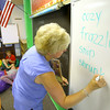 6-17-14   --- iRead summer reading program to help those kids with that are struggling with reading. teacher Jill Canady writes down words that the kids identify from a book that are new or difficult to spell. --<br />   Tim Bath | Kokomo Tribune