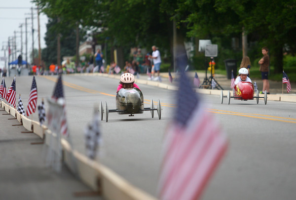 6-21-14<br /> Soap box Derby<br /> Brittany Allen and Shayden Swinson race down the hill on Main Street during the soap box derby on Saturday.<br /> Kelly Lafferty | Kokomo Tribune