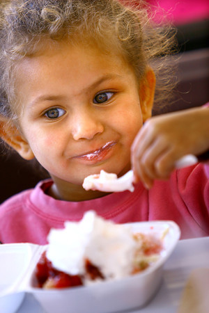 6-5-14   --- Adison Hizer, 3, eating ice cream from her strawberry shortcake at Strawberry Festival downtown. --<br />   Tim Bath | Kokomo Tribune