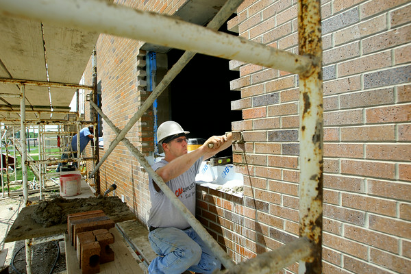 6-17-14   --- Wallace School for the Integrated Arts being added to. Kevin Zimmerman working for Ziolkowski Contruction who is subcontracted by Dallman to do the brick work. --<br />   Tim Bath | Kokomo Tribune