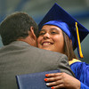 5-31-14<br /> Tri Central graduation<br /> Kimberly Martin gets a hug as she walks across the stage during Tri Central's graduation ceremony.<br /> Kelly Lafferty | Kokomo Tribune