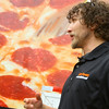 6-17-14   --- Little Caesars set up a truck giving pizza away at the Kokomo Rescue Mission on Tuesday. Andy Earl, owner of the franchise, talks about giving back to the community. --<br />   Tim Bath | Kokomo Tribune