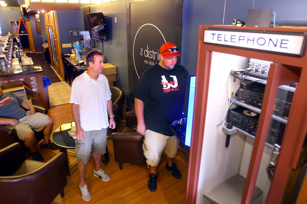 6-2-14   --- New downtown bar called the district opening June 5. Owner is Todd Rudicel. With Todd watching Tom Collins from Ace Music works on the new sound system. --<br />   Tim Bath   Kokomo Tribune