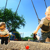 6-3-14   --- Cousins Elias Howell, 3, and Dawson Howell, 3, playing on the swings at Eastern Elementary School in Greentown. --<br />   Tim Bath | Kokomo Tribune