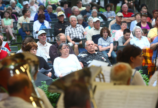 6-12-14<br /> Kokomo Park Band<br /> The audience listens to the first concert of the Kokomo Park Band's 2014 summer season on Wednesday night in Highland Park.<br /> Kelly Lafferty | Kokomo Tribune