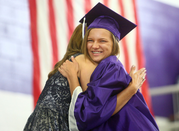 6-7-14<br /> Northwestern Graduation<br /> Northwestern senior McKenzie Mates hugs principal Kristen Bilkey before walking the stage to receive her diploma.<br /> Kelly Lafferty | Kokomo Tribune