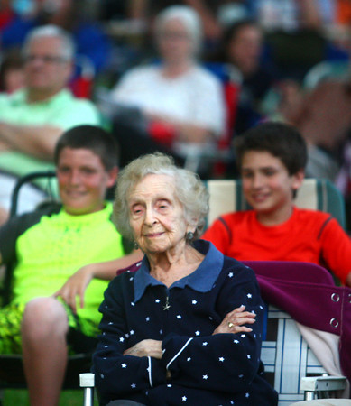 6-12-14<br /> Kokomo Park Band<br /> Henrietta Mervis smiles as she listens to the music put on by the Kokomo Park Band's first concert in the summer season at Highland Park.<br /> Kelly Lafferty | Kokomo Tribune