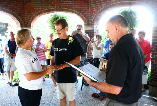 6-27-14 <br /> Bruce and Darrell Blasius are married by Mayor Greg Goodnight underneath the gazebo across from City Hall on Friday afternoon.<br /> Kelly Lafferty | Kokomo Tribune