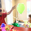 6-18-14<br /> Kokomo Rescue Mission birthday<br /> Arron Shelby and his 3-year-old Aniah play with a balloon together at the Kokomo Rescue Mission's birthday celebration on Wednesday.<br /> Kelly Lafferty | Kokomo Tribune