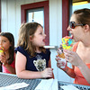 6-3-14<br /> Greentown<br /> Amy Castillo shows her daughter Brooklynn England the ice cream on her tongue, as Castillo's other daughter Mia enjoys her ice cream cone at Kelly's Ice Cream in Greentown.<br /> Kelly Lafferty | Kokomo Tribune