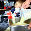 6-10-14   --- Kids volunteer at Urban Outreach in a new program called Kids4Kids. Aidyn Facemyer, 4, scooping laundry detergent that will be placed in ziploc bags to be given out in the food pantry.  --<br />   Tim Bath | Kokomo Tribune