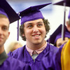 6-7-14<br /> Northwestern Graduation<br /> Dylan Collins smiles as he listens to the valedictorian speech during Northwestern High School's graduation ceremony.<br /> Kelly Lafferty | Kokomo Tribune