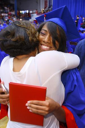 6-6-14   --- Ma-Ryssa Martin hugs her mother Carmalita Thomas after walking the stage at KHS Graduation. --<br />   Tim Bath | Kokomo Tribune