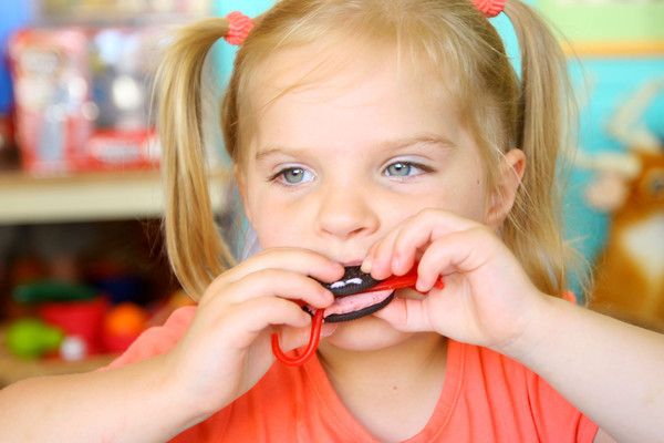 6-5-14   --- Myra Weight, 3, eating the strawberry spider she made at Planet Mind during the Strawberry Festival downtown. --<br />   Tim Bath | Kokomo Tribune