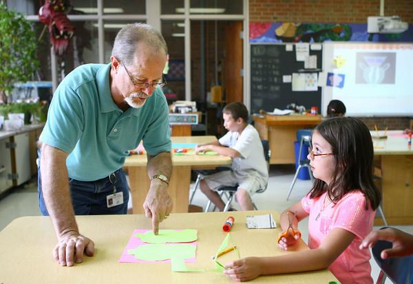 5-29-14<br /> Paul Buesking's art class at Bon Air<br /> Isabella Bashore listens to art teacher Paul Buesking as he helps her with an in-class art assigment.<br /> Kelly Lafferty | Kokomo Tribune