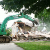 6-24-14<br /> A house is torn down on South Union on Tuesday afternoon.<br /> Kelly Lafferty | Kokomo Tribune