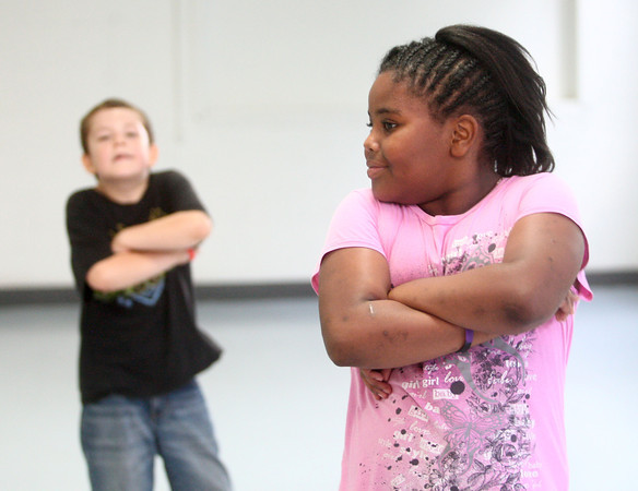 6-12-14<br /> Carver Community Center Hip Hop Class<br /> Myranda Jackson, 9, practices moves for a routine Carver Community Center's Hip Hop Class will perform today.<br /> Kelly Lafferty | Kokomo Tribune