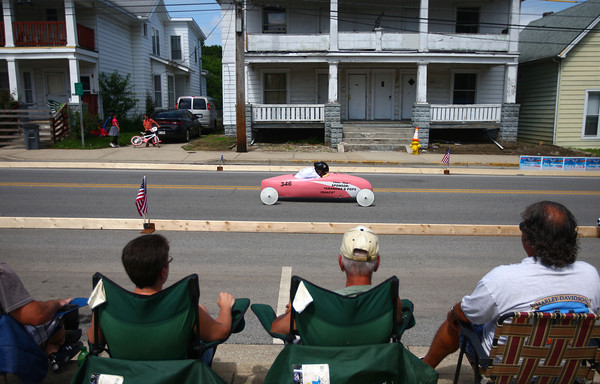 6-21-14<br /> Soap box Derby<br /> The audience watches at Emma Shaw, 13, rolls down Main Street during Saturday's soap box derby.<br /> Kelly Lafferty | Kokomo Tribune