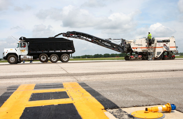 6-20-14<br /> Grissom Runway<br /> The asphalt milling machine is taken down Grissom's taxiway A, grinding up old asphalt.<br /> Kelly Lafferty | Kokomo Tribune