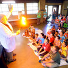 "6-3-14   --- ""Sizzlin'"" Sam Wendel does science demonstrations that wows and excited kids at Rogers Pavilion at Highland Park. Sam lights a piece of flash paper. --<br />   Tim Bath 