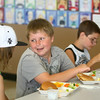 6-24-14<br /> Taylor Primary Lunch<br /> Peyton Leveridge, 9, (center) eats lunch and talks with Logan Colburn, 11, and Dakota Cox, 12 at Taylor Primary School.<br /> Kelly Lafferty | Kokomo Tribune