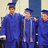 5-31-14<br /> Tipton graduation<br /> Codey Thomas, Cody Vandevender, and Anderson Williams are the last to walk into Tipton's gymnasium on Saturday during the graduation processional.<br /> Kelly Lafferty | Kokomo Tribune