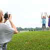 6-24-14<br /> Erica Collins photographs her children Brenden, 7, Aspen, 9, and Dallas, 2, at Jackson Morrow Park.<br /> Kelly Lafferty | Kokomo Tribune