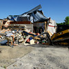 6-5-14   --- Soupleys at Lincoln and S. Lafountain Street being taken down seven months after being destroyed by the tornado in November. Mulch Worx out of Ft. Wayne is doing the demo work. --<br />   Tim Bath | Kokomo Tribune