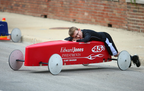 6-21-14<br /> Soap box Derby<br /> Aiden Trainer hangs out by his car at the top of the hill on Main Street during the soap box derby on Saturday.<br /> Kelly Lafferty | Kokomo Tribune