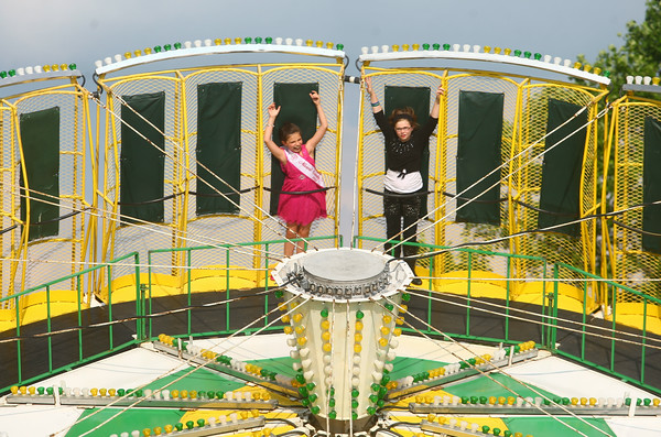 6-25-14<br /> Miami County Fair<br /> Miami County Princess Elizabeth Pavey, 9, and her 10-year-old sister Emma, take a spin on one of the rides at the Miami County Fair.<br /> Kelly Lafferty | Kokomo Tribune
