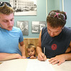 6-25-14<br /> First Howard County same sex marriage<br /> Brandon Patrick and Joshua Day sign marriage paperwork at the Howard County Courthouse as Day's 7-year-old son Cayden Day peeks in between them. They will be the first same sex couple to get married in Howard County.<br /> Kelly Lafferty | Kokomo Tribune