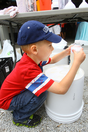 6-10-14   --- Kids volunteer at Urban Outreach in a new program called Kids4Kids. Colin Nichols5, labeling a bottle of dishwashing soap that will be given out in the food pantry.  --<br />   Tim Bath | Kokomo Tribune