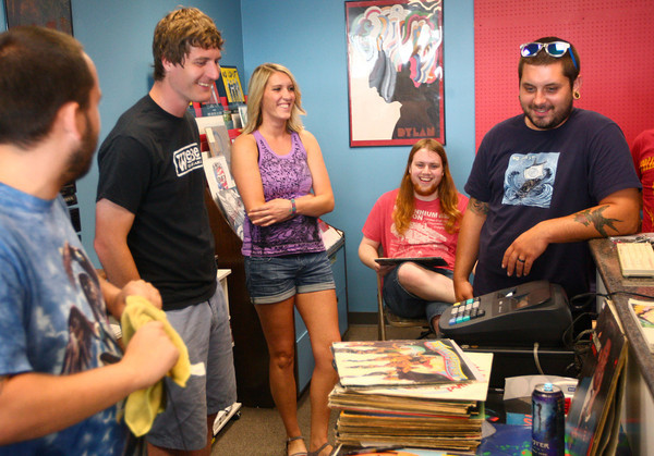 6-20-14<br /> American Dream HiFi<br /> A group hangs out inside American Dream HiFi, a record store on Center Road opening later this month.<br /> Kelly Lafferty | Kokomo Tribune