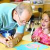 5-29-14<br /> Paul Buesking's art class at Bon Air<br /> Art teacher Paul Buesking listens to a question from second grader Arieonna Long in art class.<br /> Kelly Lafferty | Kokomo Tribune
