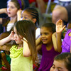 "6-3-14   --- ""Sizzlin'"" Sam Wendel does science demonstrations that wows and excited kids at Rogers Pavilion at Highland Park.  Penelope Wilson and Sanae Geyton cover ears and react to a lowd explosion sound when presure popped a cork from a bottle. --<br />   Tim Bath 