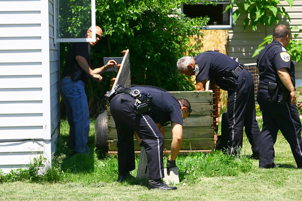 5-30-14   --- Shooting a 810 N Main Street on Friday afternoon. Kokomo Police and Howard County Deputies search the area after a witness claimed they say the gunman leaving the scene with a gun. The suspected gunman said the gun was in the house. --<br />   Tim Bath | Kokomo Tribune
