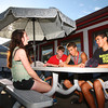 6-3-14<br /> Greentown<br /> From left: Georgie Epp, Trevor Buchanan, Braden Evans, and Trey Thomas hang out in front of Kelly's Ice Cream in Greentown.<br /> Kelly Lafferty | Kokomo Tribune