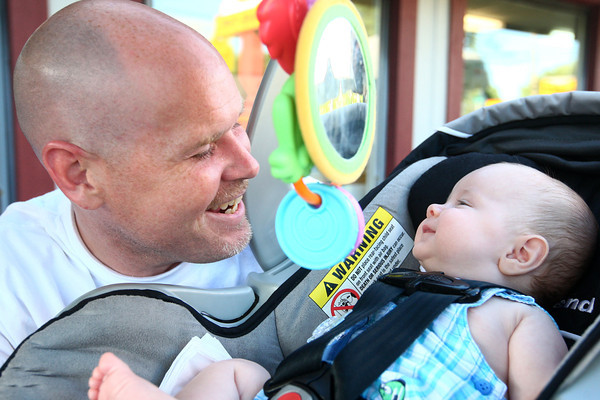 6-3-14<br /> Greentown<br /> Denny Carey tries to make baby Mason Carey smile after he wakes up from a nap in front of Kelly's Ice Cream in Greentown.<br /> Kelly Lafferty | Kokomo Tribune